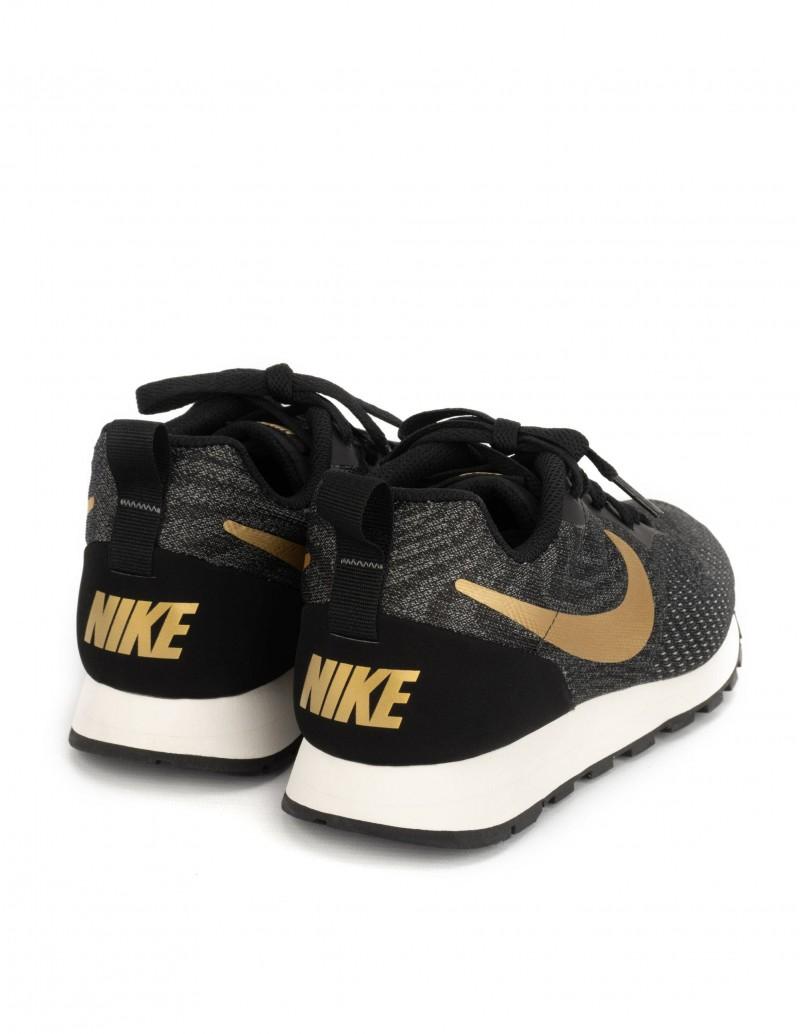 zapatillas hombre nike negras y doradas